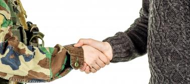 Handshake between military representative and civilian